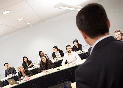 Instructor and students in class