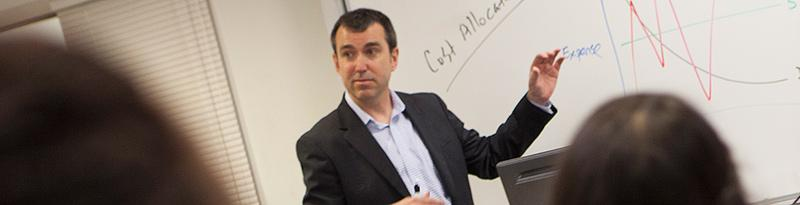Photo of professor Chris Burnley teaching a class